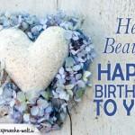 Steinherz mit Blüten und Geburtstagsspruch