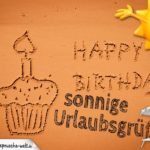 Muffin zum Geburtstag und Happy Birthday in den Uralubsstrand geschrieben