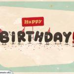 Happy Birthday Karte, dessen Buchstaben Füße, Gesichter und Arme haben