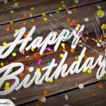 Happy Birthday Karte mit Holzboden, Konfetti und Sektgläsern in 3D