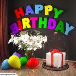 Happy Birthday Glückwunschkarte mit Margeriten-Blumenstrauß, Luftballons und Geschenk unter Glasglocke